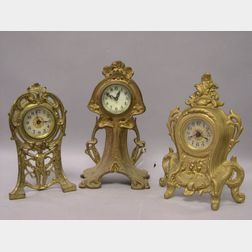 Three Rococo-style and Art Nouveau Gilt Cast Metal Timepieces