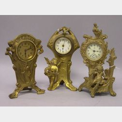 Three Rococo-style and Art Nouveau Gilt Cast Metal Figural Timepieces