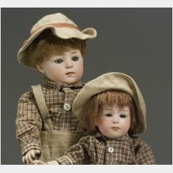 Pair of Heubach Glass-Eyed Pouty Children
