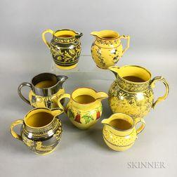 Seven Staffordshire Yellow-glazed Ceramic Jugs