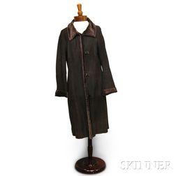 Akris Full-length Brown Shearling Coat.     Estimate $800-1,000