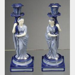 Pair of Wedgwood Queen's Ware Figural Candlesticks