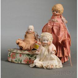Three Small Bisque Dolls
