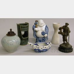 Five Pieces of Asian and Studio Ceramics and a Cast Metal Figure of a Chinese   Carrier with Boxes of Tea