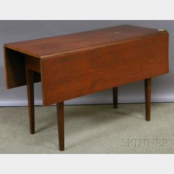 Federal Maple and Cherry Drop-leaf Table with Molded Tapering Legs.