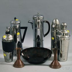 Five Cocktail Shakers, a Bowl, and a Pair of Candlesticks