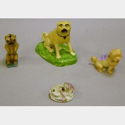 Group of Four Porcelain and Creamware Pug Figures and Figural Groups