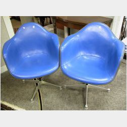 Pair of Eames Blue Upholstered Swivel Armchairs.