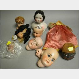Nine Miscellaneous Doll Heads