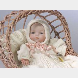 AM Dream Baby in Wicker Cradle