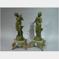 Pair of L. and F. Moreau Art Nouveau Patinated Metal Figures on Onyx and Gilt-metal Mounted Bases.