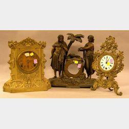 Victorian Gilt Cast Metal Mantel Clock, a French-style Gilt Cast Metal Table Clock, and a Patinated Cast Metal Moorish Figural Mantel C
