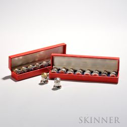 Two Boxed Sets of Cartier Sterling Silver Salt and Pepper Shakers, mid to late 20th century, sixteen total, eight with gold-washed lids