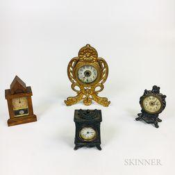 Four Mostly Metal Desk Clocks