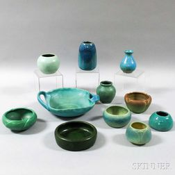 Eleven Pieces of Mostly Rookwood, Van Briggle, Upchurch, and Claverdon Art Pottery.     Estimate $300-350