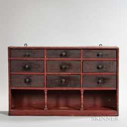 Red- and Brown-painted Compartmented Wall Shelf with Nine Drawers
