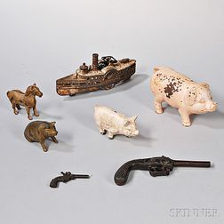 Seven Cast Iron Banks and Toys