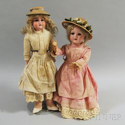 Two German Bisque Head Girl Dolls