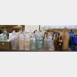 Approximately 156 Colorless, Aqua, and Colored Glass Bottles