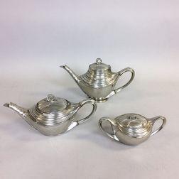 Three Art Nouveau-style Aluminum Teapots