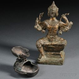 Buddhist Sculpture and Oil Lamp