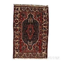 Shirvan Rug, East Caucasus, c. 1910, the large deep aubergine lozenge inset with a blue/aubergine cruciform device in a red medallion f