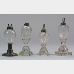 Four Colorless Glass Fluid Lamps