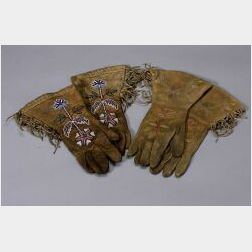 Two Pairs of Decorated Hide Gauntlets