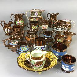 Twenty Copper Lustre Ceramic Vessels.     Estimate $20-200