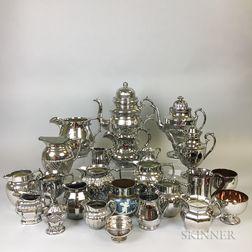 Twenty-four Silver Lustre Ceramic Tableware Items.     Estimate $20-200
