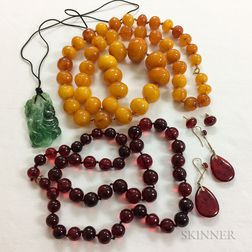 Amber Bead Necklace, a Resin Bead Necklace and Two Pairs of Earrings, and a Carved Jadeite Pendant.     Estimate $150-250