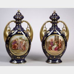 Pair of Vienna-style Porcelain and Parcel-gilt Covered Vases