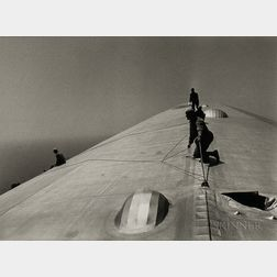 Alfred Eisenstaedt (American, 1898-1995)      Repairing the Hull of the Graf Zeppelin During the Flight over the Atlantic