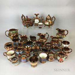 Thirty Copper Lustre Ceramic Vessels.     Estimate $20-200