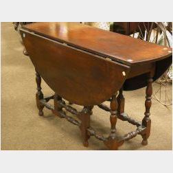 William and Mary Style Cherry Drop-leaf Gateleg Table.