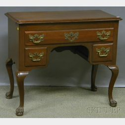 Queen Anne-style Carved Walnut Dressing Table with Paw Feet.