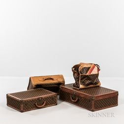 Four Pieces of Louis Vuitton Luggage and a Book