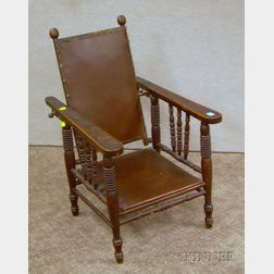 Childs Late Victorian Oak Spindle-sided Adjustable-back Morris Chair.