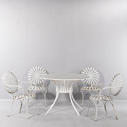 Four Francois Carre Sunburst Chairs and Glass-top Sunburst Table
