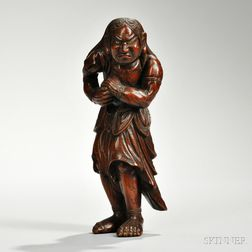 Wood Carving of a Figure