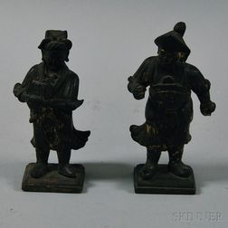 Two Japanese Black-painted and Gilt-decorated Carved Wooden Figures