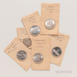 Five Uncirculated 1935-39 Canadian Dollars and a 1945 50 Cent.     Estimate $200-400