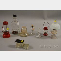 Four Miniature Lighting Devices, Two Banks, and Two Candy Containers