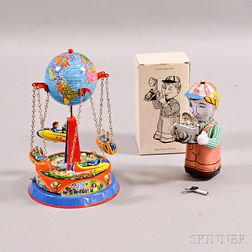 Josef Wagner Tin Carousel and a Modern Tin Wind-up Toy of a Photographer.     Estimate $50-75