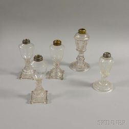 Five Colorless Pressed Glass Whale Oil Lamps.     Estimate $200-400