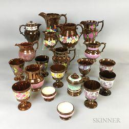 Forty Copper Lustre Ceramic Vessels.     Estimate $20-200