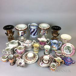 Thirty Pieces of Lustre Ceramic Tableware.     Estimate $20-200