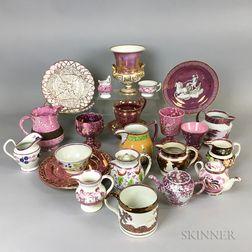 Twenty-five Pink Lustre Ceramic Tableware Items.     Estimate $20-200