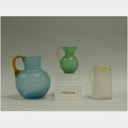 Five Colored and Colorless Ice Chip Art Glass Pitchers.