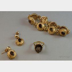 14kt Gold and Smokey Quartz Bracelet and Earrings Suite and a 14kt Gold and Smokey   Quartz Ring.      Estimate $300-500